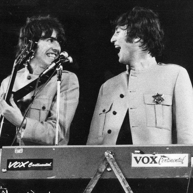 I miss these guys a lot.  Great shot of George and John during the first Shea Stadium concert, August 1965.