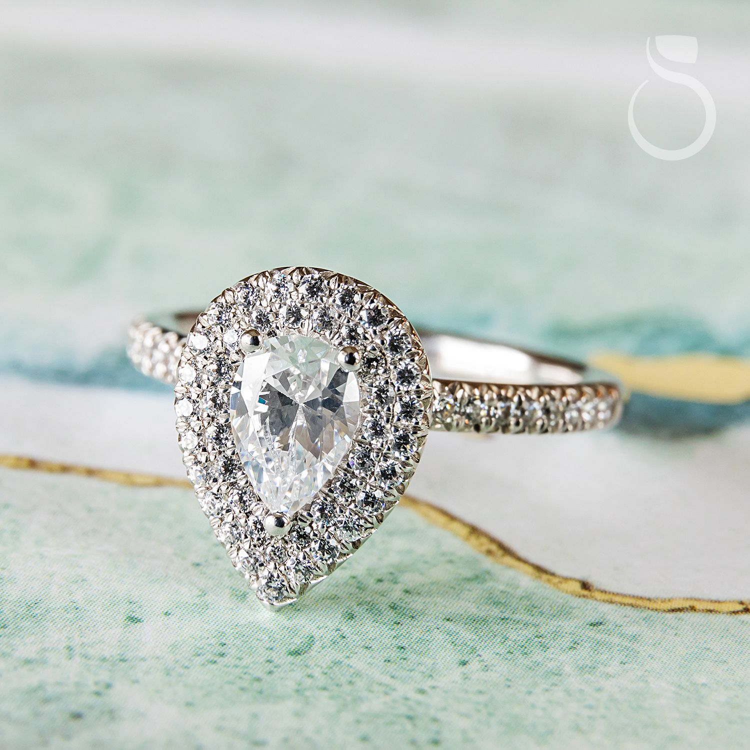 """Add the """"pearfect"""" touch with this pear-shaped, double halo engagement ring!  sylviecollection.com (Style no. S1495)  #SylvieCollection #SomethingSylvie #GetEngagedWithSylvie #EngagementRing #Diamonds #Jewelry #RingOfTheDay #Fashion #Style #JewelryTrends"""
