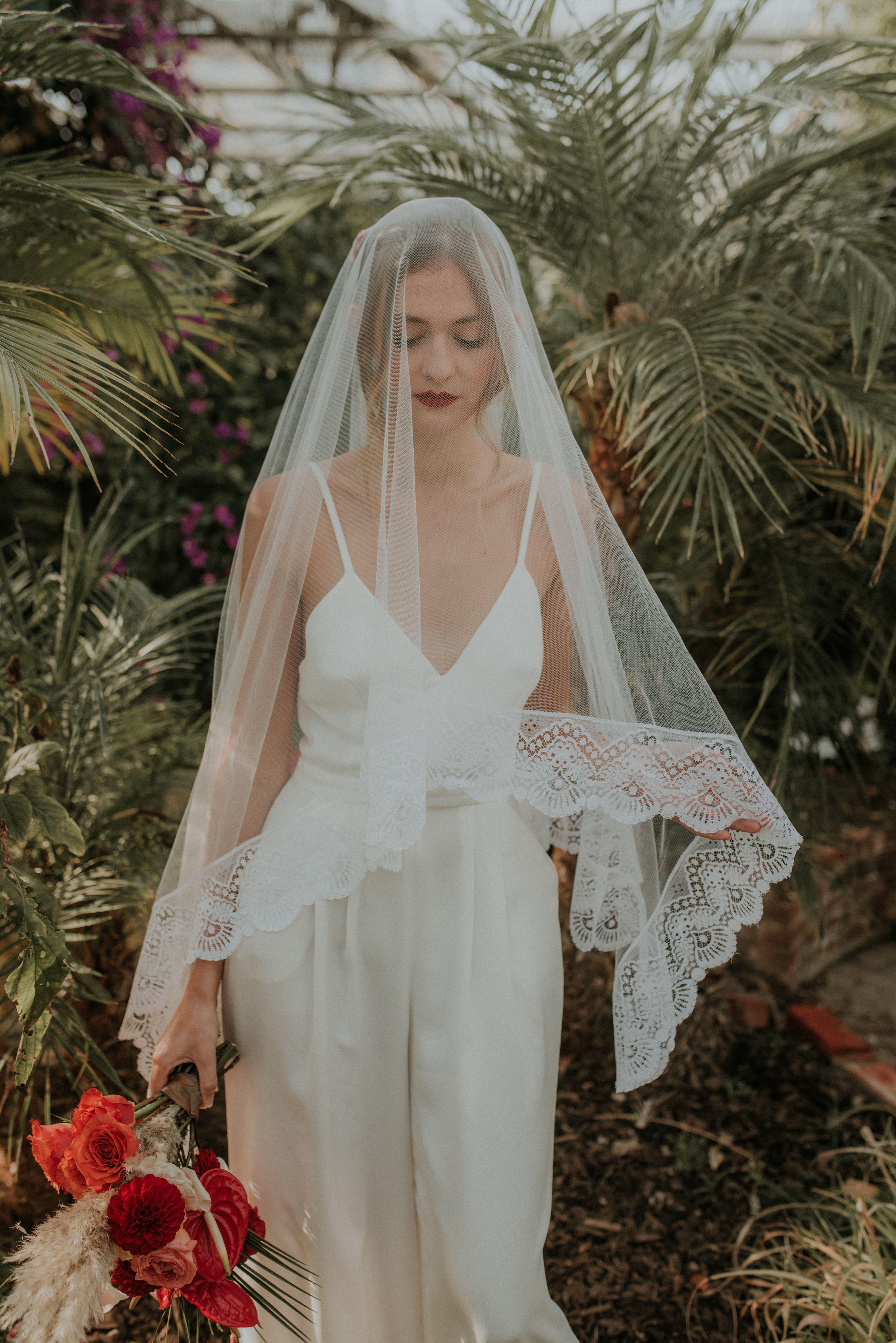 Bride In Jumpsuit And Mantilla Veil White Bridal Jumpsuit Veil