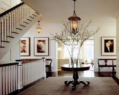 Living a beautiful life hall with round table and spray of flowers foyer ideasdecor