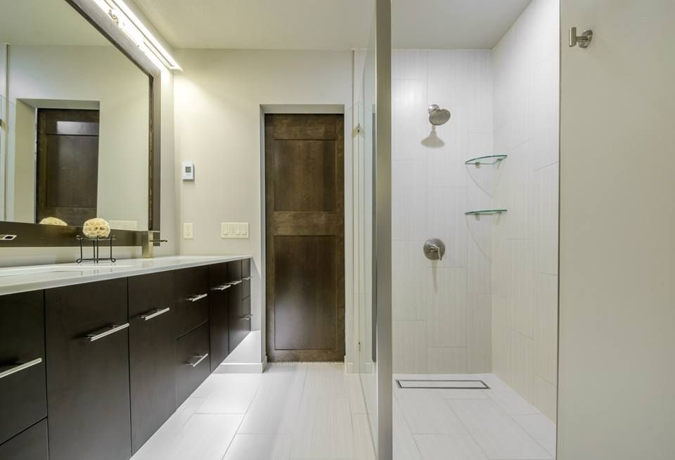 Bright Open Areas Complement Dark Wood To Create A Timeless Feel - Bathroom remodel la crosse wi