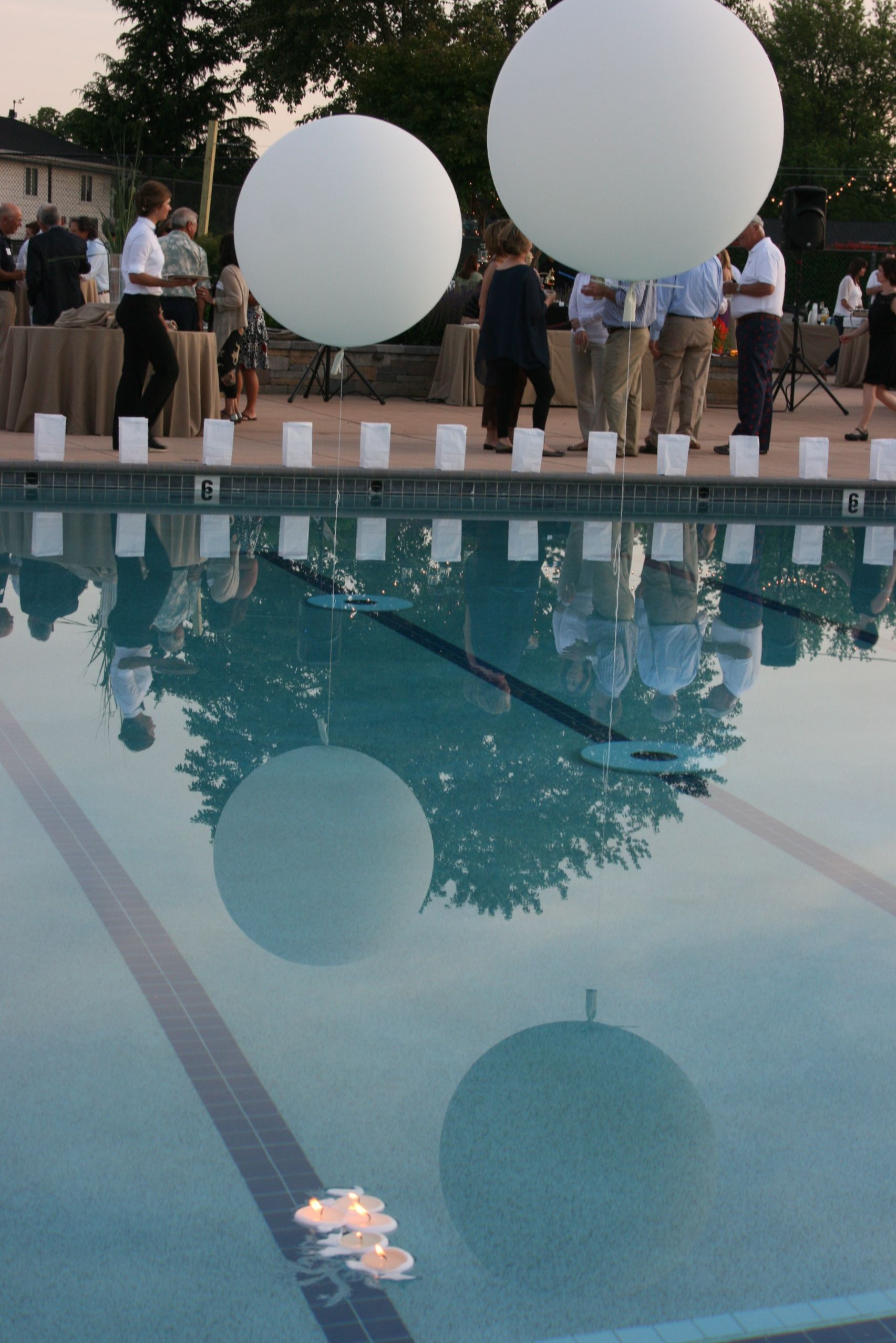 Large Balloon With Weighted Ends In Pool Wedding Pool Party