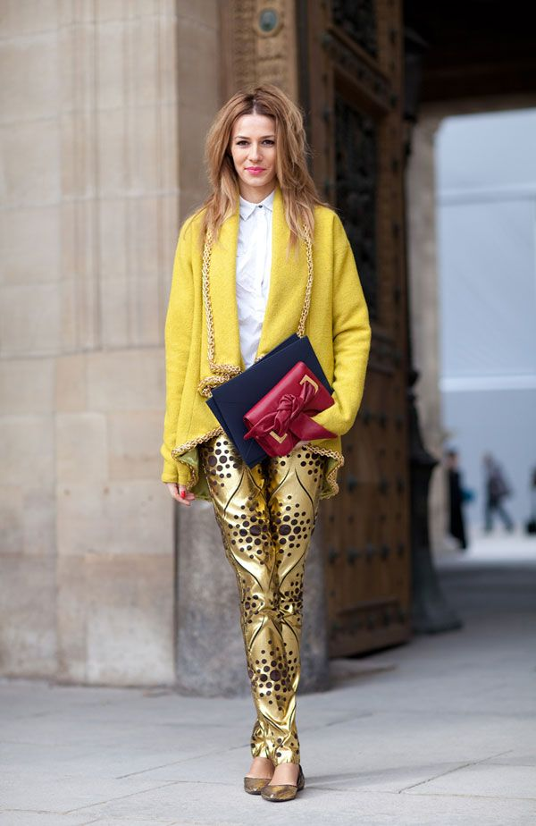 yellow sweater and gold flats