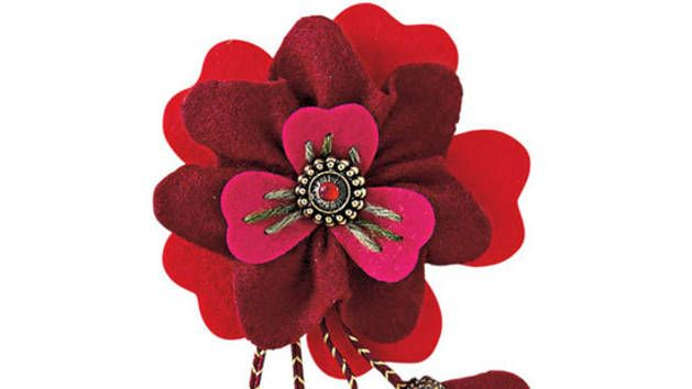 Make this gorgeous felt flower brooch to spruce up a plain outfit. A great way to use up felt and beads from your craft stash, it also makes a lovely gift. #DIYflower #feltflower #DIYjewelry #beads  3 colors of felt. https://au.lifestyle.yahoo.com/better-homes-gardens/craft/h/16939362/how-to-make-a-felt-flower-brooch/