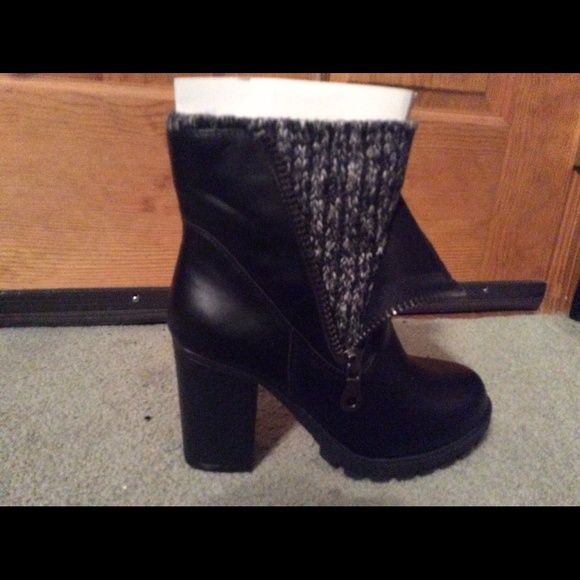 Black chunky heel boot sz7 Chunky black heeled boot. Sweater lining, zipper closure. Brand new in box! Charlotte Russe Shoes Ankle Boots & Booties