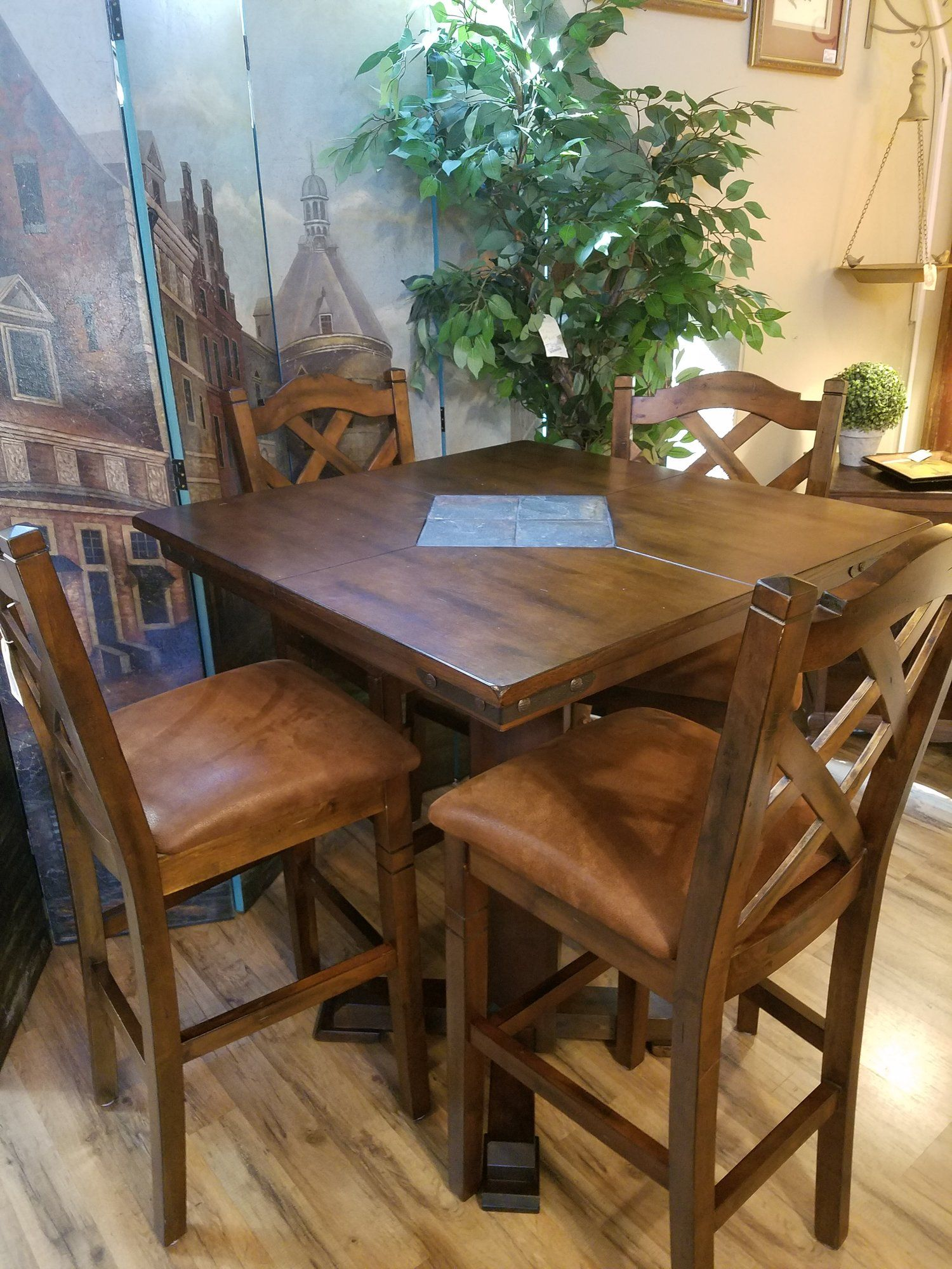 pub table and 4 chairs. slate tile design in middle of the table