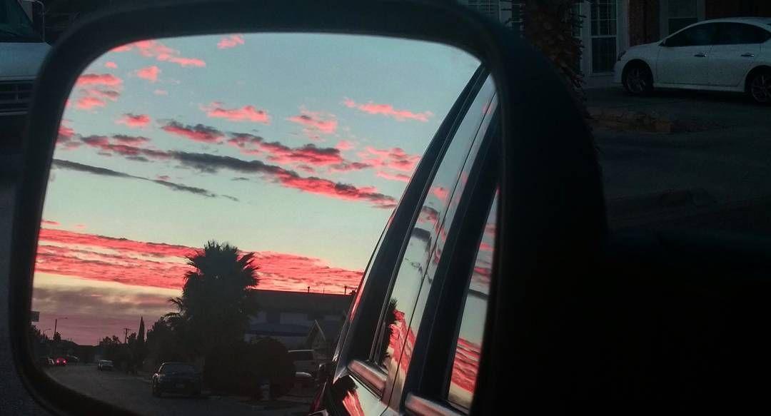 Sometimes what you leave behind is beautiful but you can't go back. Got to keep on going.  #morning #rearviewmirror #clouds #sky #redclouds #onmywaytowork #landscape #neighborhood #driveandsnap #buenosdias #vista de mi #espejoretrovisor #nubesrojas #cielo #skyporn #cloudporn #caminoaltrabajo #aseguirle. #elpasosky #itsallgoodep by ela_may