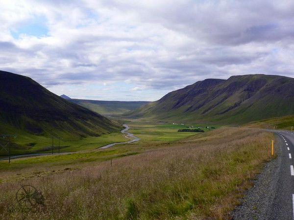 Valley carpeted with green grass. Iceland Fire & Ice Motorcycle Adventure with MotoQuest : https://www.motoquest.com/guided-motorcycle-tours/iceland.php