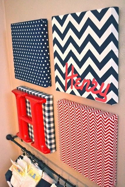 Photo of Fabric-covered canvas nursery art and hanging diaper organizers – NewlyWoodwards