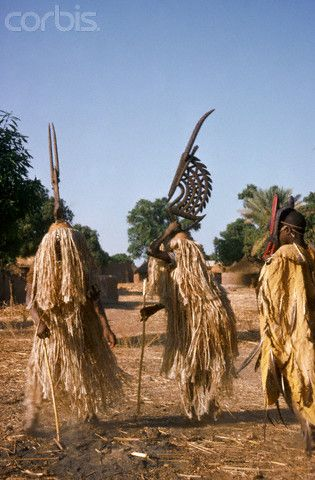 Africa | Bambara men wear antelope masks to dance to Tyi-Wara, the mythological half man, half antelope, who is believed to bring good luck to farmers. Mali. | Image and caption © Charles & Josette Lenars