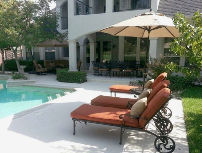 Augustine Chaise Lounge Chairs Under A Treasure Garden Auto Tilt Umbrella  With The St. Augustine Deep Seating And Dining In The Background   Yard Art  Patio ...