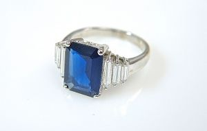 Sapphire and baguette cut diamond ring
