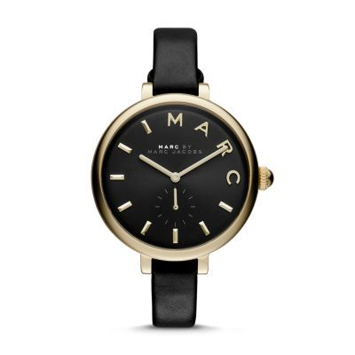 Sally Three Hand Leather Watch - Black A study in contrasts, the Marc by Marc Jacobs Sally timepiece plays an oversized black sunray dial accented with a gold-tone case and numerals off a polished black leather strap.