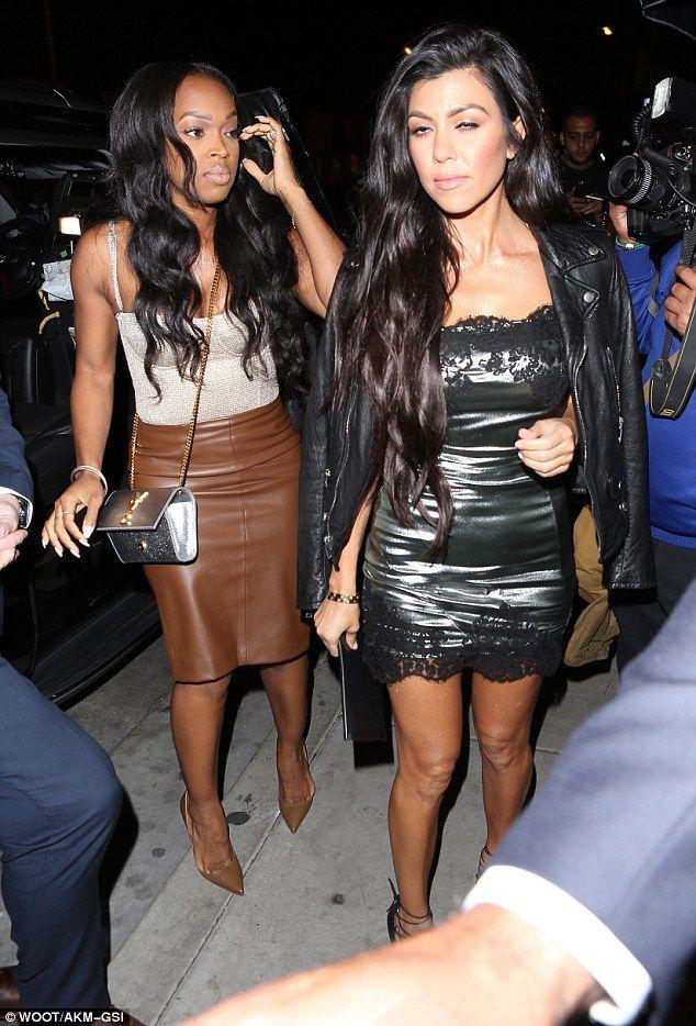 Khloe Kardashian flashes her underwear in a see-through