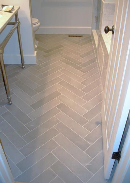 Soothing Gray Tile Set In A Herringbone Pattern Give This Small Bath Distinction