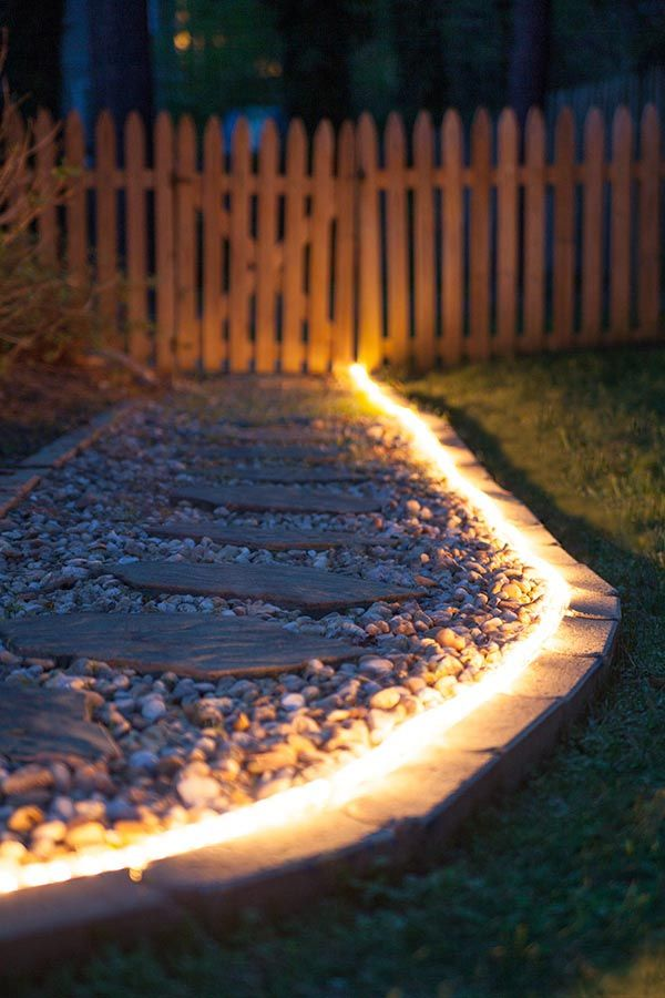 Brighten gardens and walkways using rope light as pathway lights great along stone walkways and a perfect diy idea for backyard lighting and weddings too