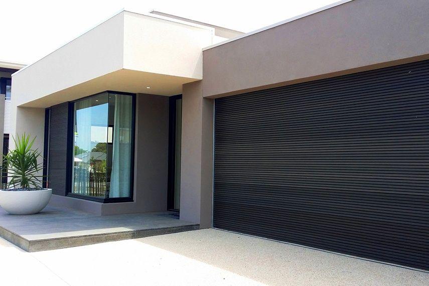 brown garage doorsBiowood Black Brown battens facade and garage door  Fachadas