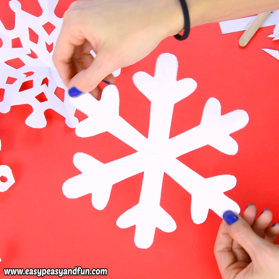 it's time to learn how to make paper snowflakes , as these are the best DIY winter decoration, and with our 20 printable templates – a super easy one to make.