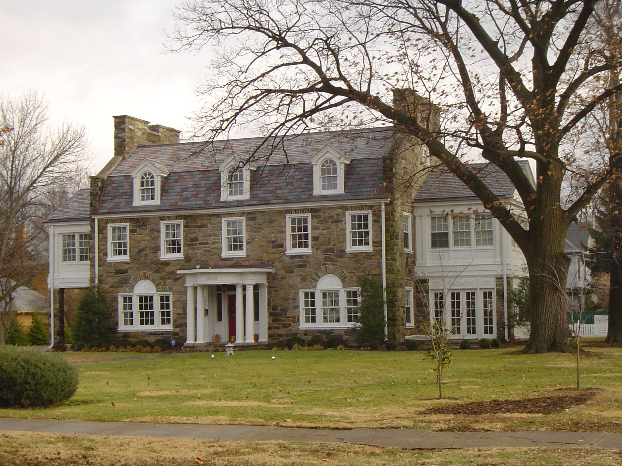 Love the fieldstone and white trim interesting use of a for Colonial home builders