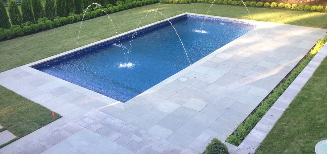 Hamptons-style rectangular pool with Deck Jets. Built using ...