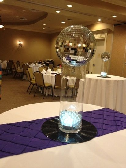 The Center Pieces Are Made With Disco Balls Sitting On Top Of A Vase  Illuminated With A Light Hidden Under White Waterbeads, For The High Boy  Tables.