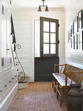 A place to take off your shoes , a Place to hang you Coats another to place you belongings all hidden from view no clutter.  Love the door too!
