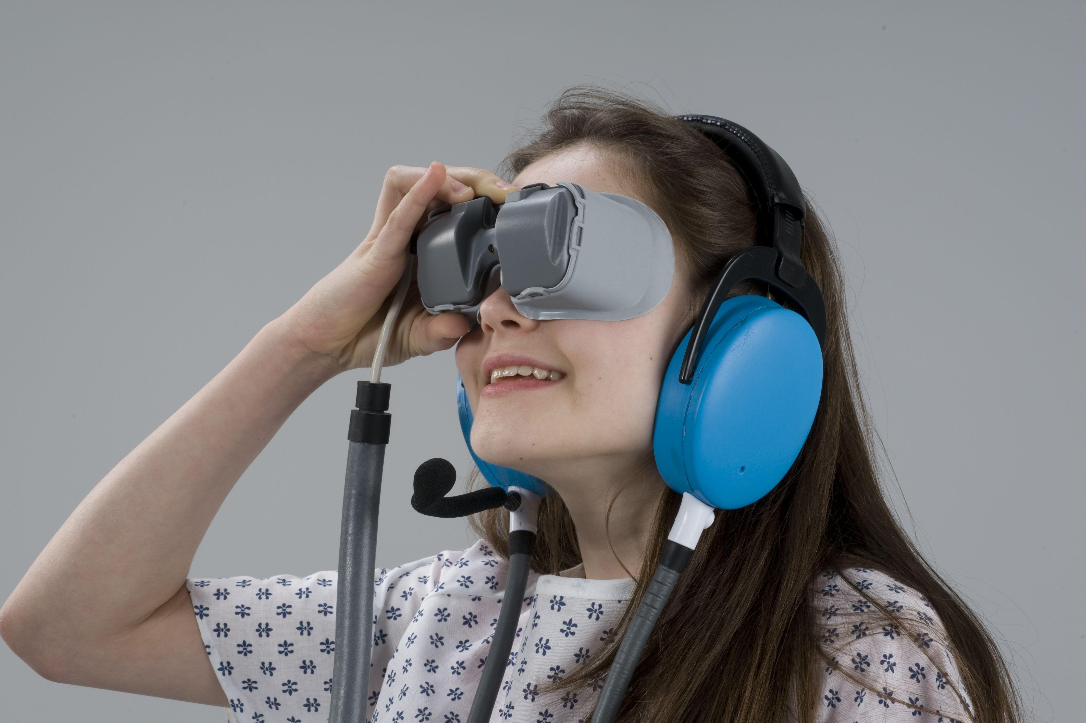 Girl MRI patient w headphones goggles Headphones