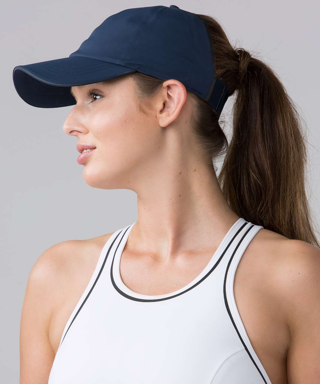 2185e0b2 Materials: Mesh, Spacer. Color: jaded. Run fast and let your hair free in  this sweat-wicking hat with a wide-back opening to help keep you cool.