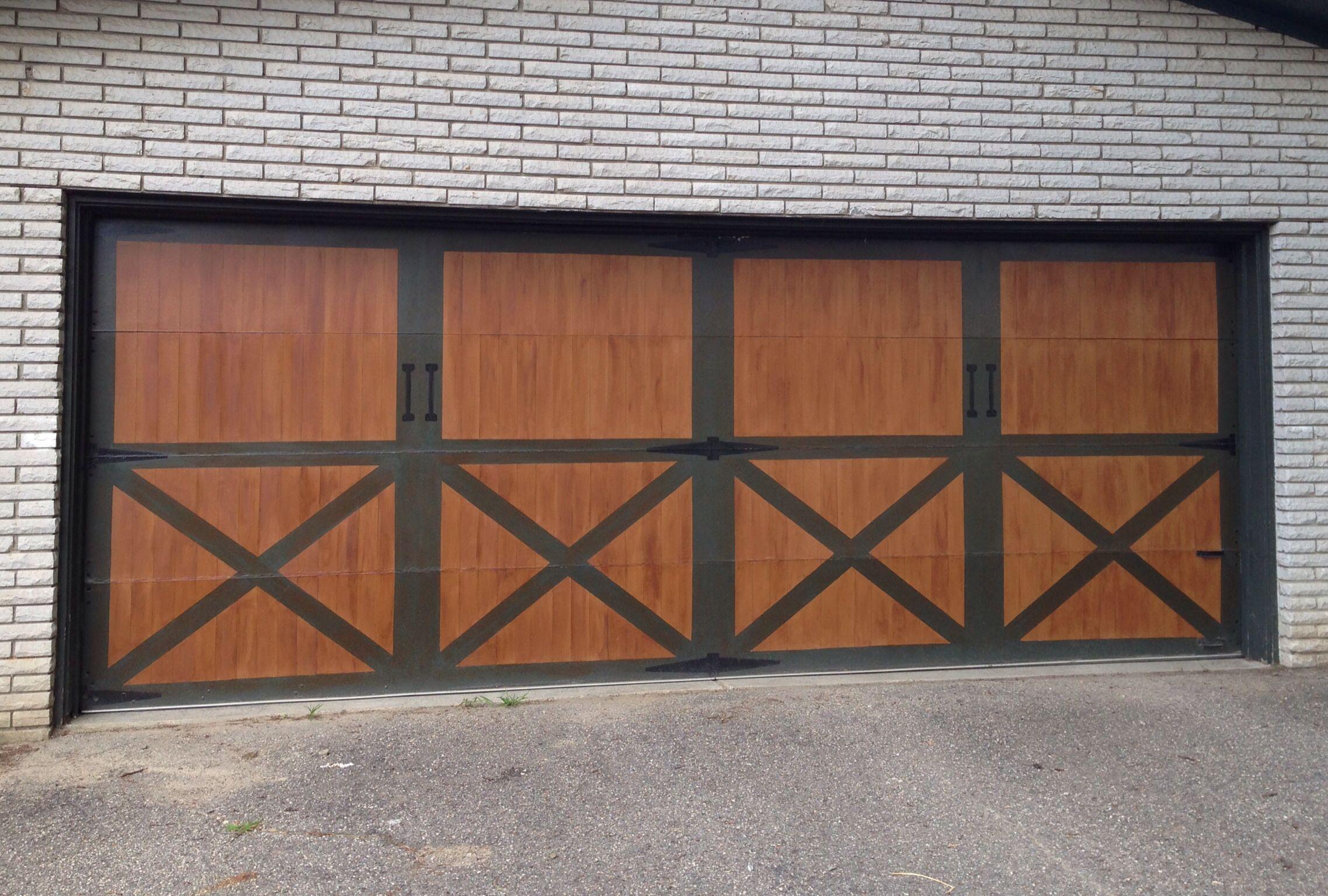 DIY Faux barn doors for garage door part 2. After painting