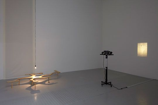 Runo Lagomarsino ContraTiempos 2010  Dia projection loop, 27 original images in a Kodak slide projection carousel with timer, variable projection size.  ContraTiempos (Model) 2010 - 11 Wood, metal, lamp and stones, 58.5 x 144 x 219 cm