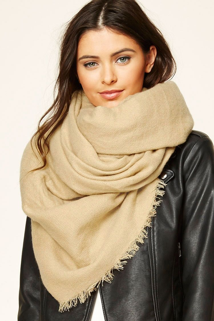 An oblong scarf crafted from a woven fabric featuring