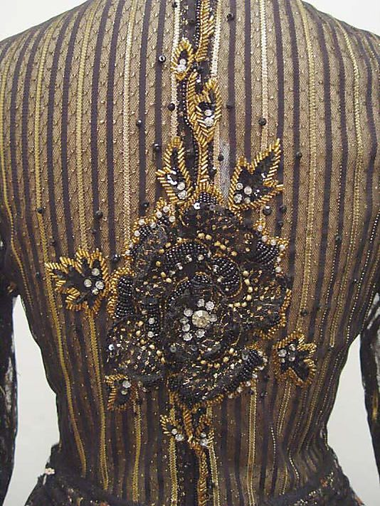 Backside of a James Galanos dress, ca. 1989. The embroidery, a rose, in   rhinestones, jet , glass and silk.                                             James Galanos