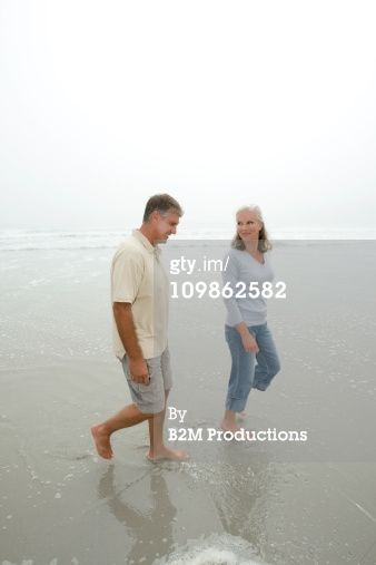 Stock Photo : Senior couple walking on the beach