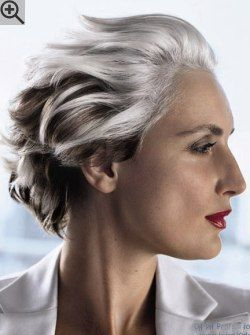 Trendy hairstyle for women with gray hair. Styled out of the face and towards the back.