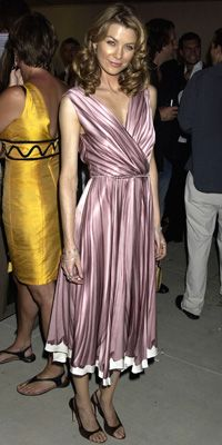 "ELLEN POMPEO IN PRADA, 2004   WHERE Prada store opening in Los Angeles  WHY WE LOVE IT ""The fabric had a beautiful movement. You could actually see the intricacies of the hand painting."""