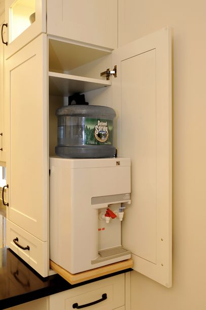 The Water Cooler Is Concealed Inside A Cabinet Easily Accessible