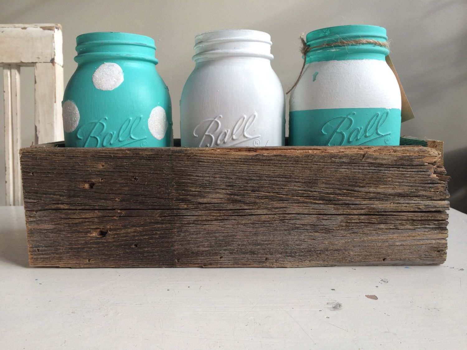 Hand chalk painted rustic quart size ball mason jars in reclaimed