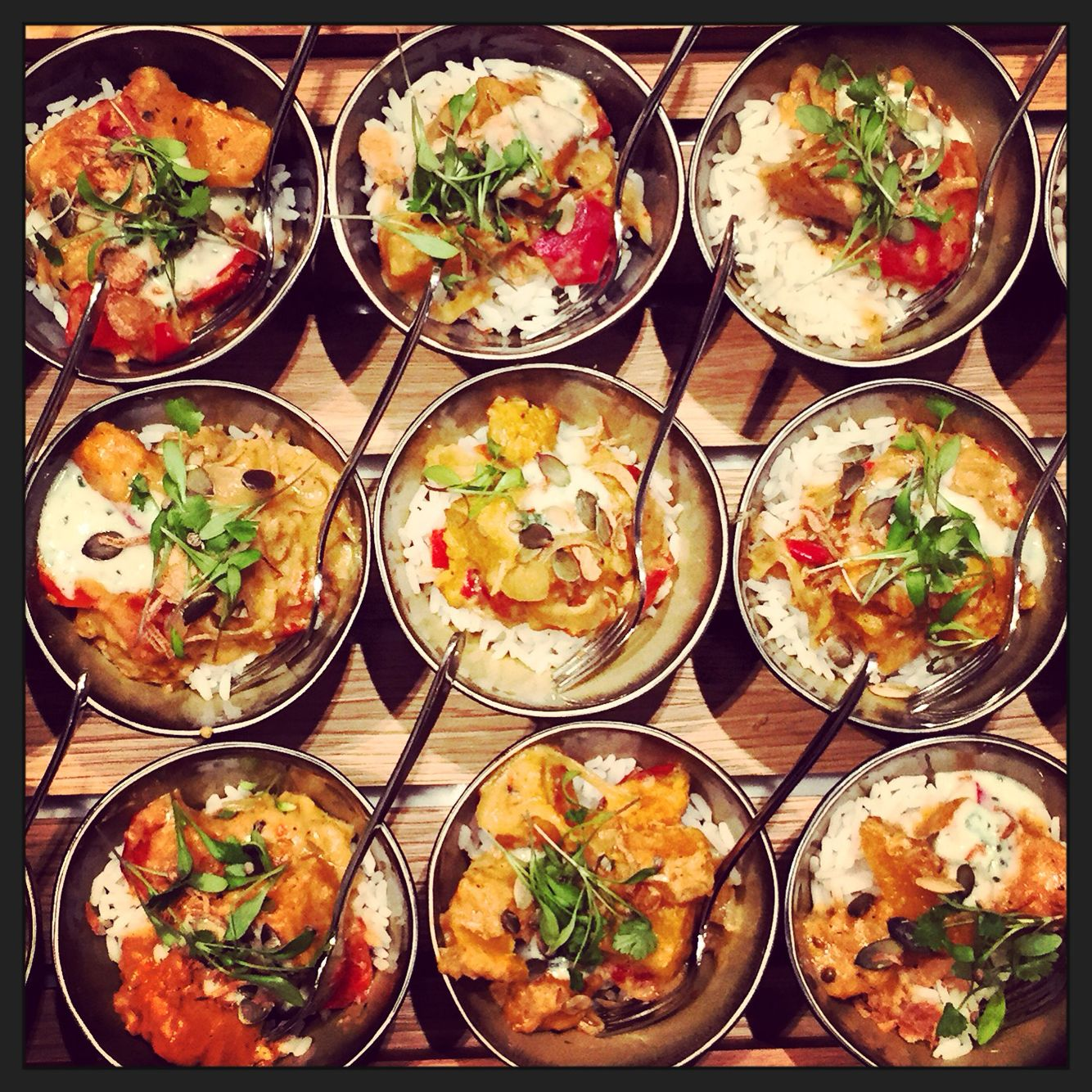 Bowl food by EventOracle. Geng Gari Curry of roast butternut, ginger and basil topped with fused coconut cream