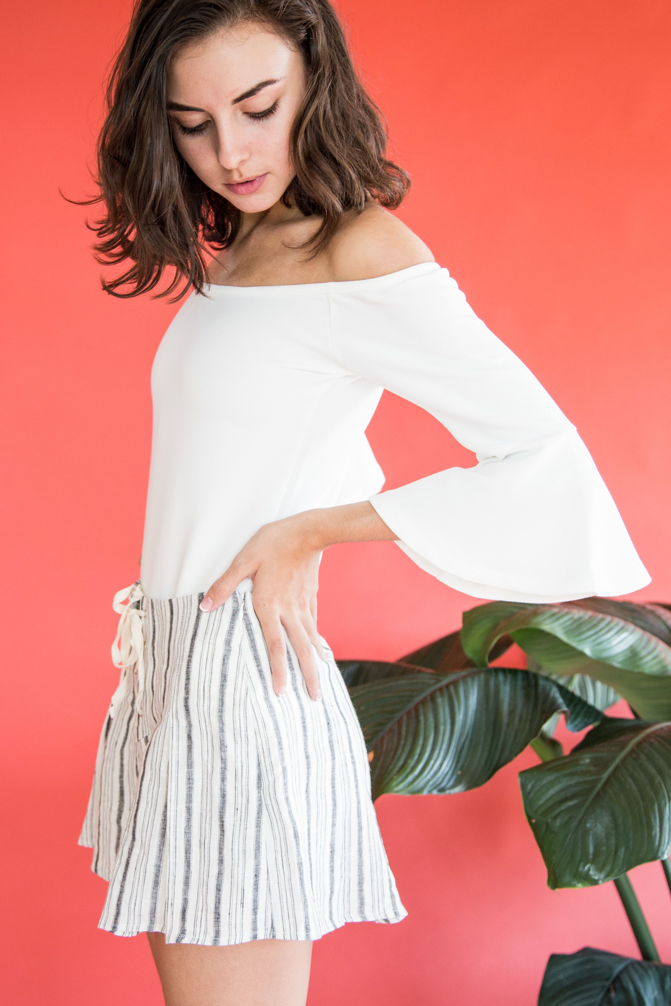 In For the Frill Off Shoulder Bodysuit.