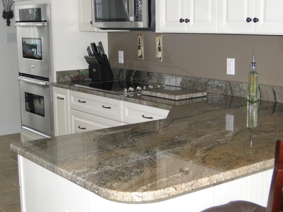 River Bordeaux granite with double wall ovens. | Granite Kitchens ...