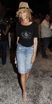 Carine Roitfeld goes west in a denim skirt.