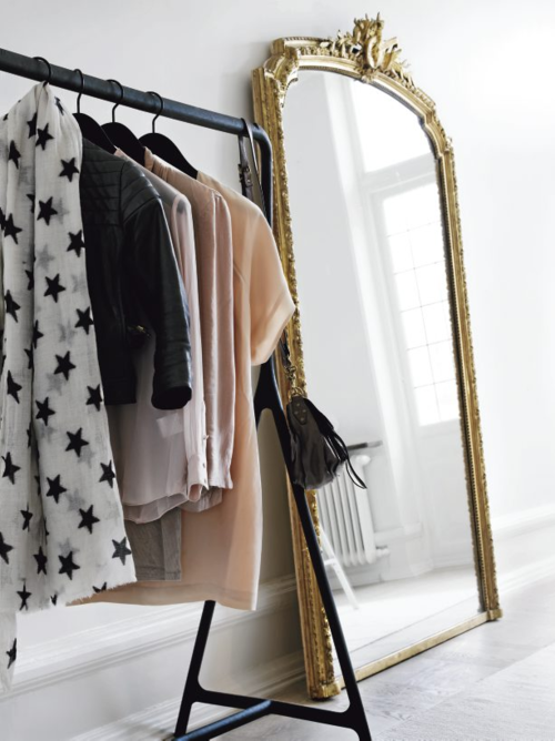 On the Dream House List: A large, bright room with racks of clothes and extra large mirrors:)