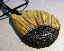 SALE! REDUCED! Polymer clay pendant featuring a sunflower design with bead-textured centre. On suede cord.