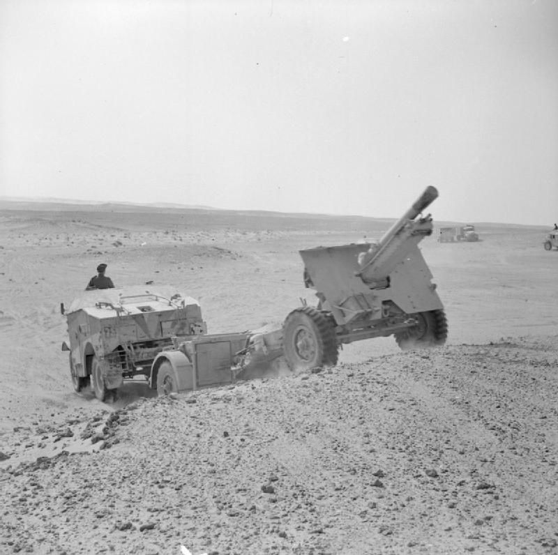 A 25-pdr field gun and 'Quad' artillery tractor in the Western Desert, 8 March 1942. #photography #war
