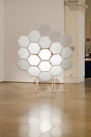 parabolic reflector    2012, wood, styrodur, aluminium pigment, 170 x 170 x 200 cm (two parts)