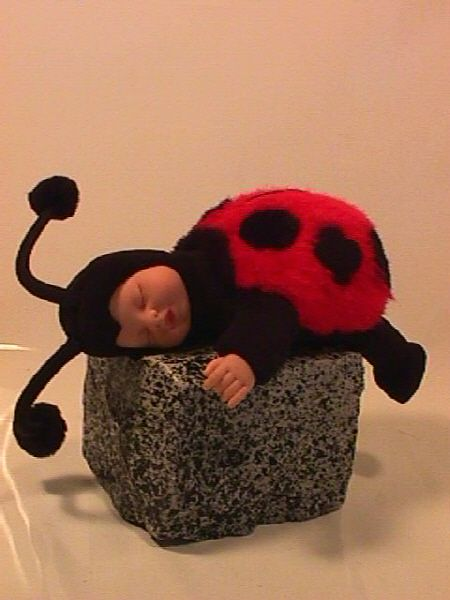 Anne Geddes- Landon and I bought this for his mimi (my adopted sister ) one year . :)