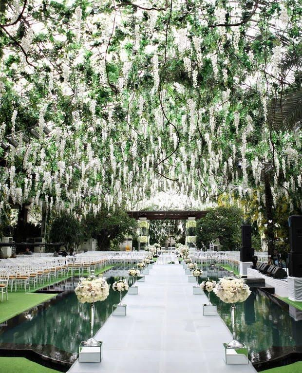 Outdoor Wedding Ceremony Whitby: Stunning Floral Canopy And Elevated Aisle To Make A Grand
