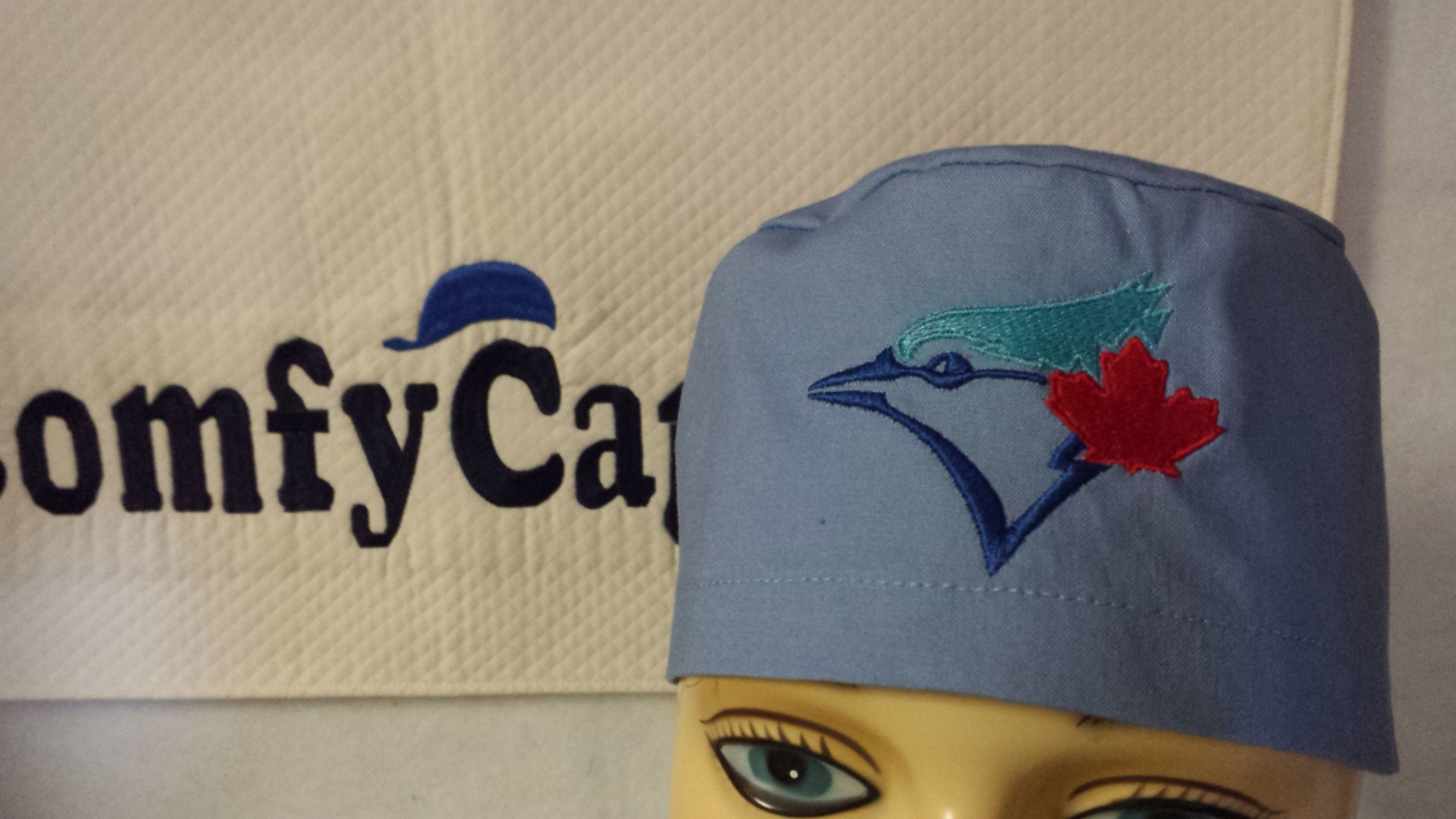 Male scrub cap embroidered with Toronto Blue Jays logo