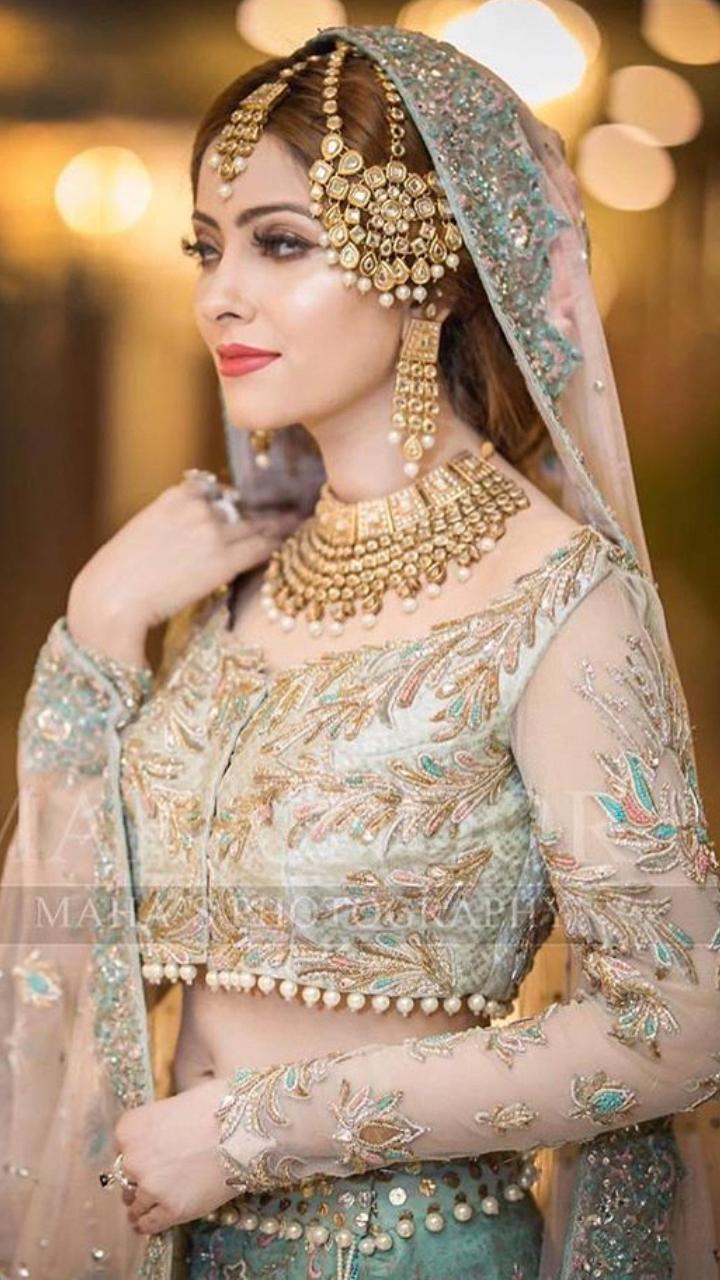 Pakistani Bride Wearing Designer Jewelry And Lehenga Choli At Her