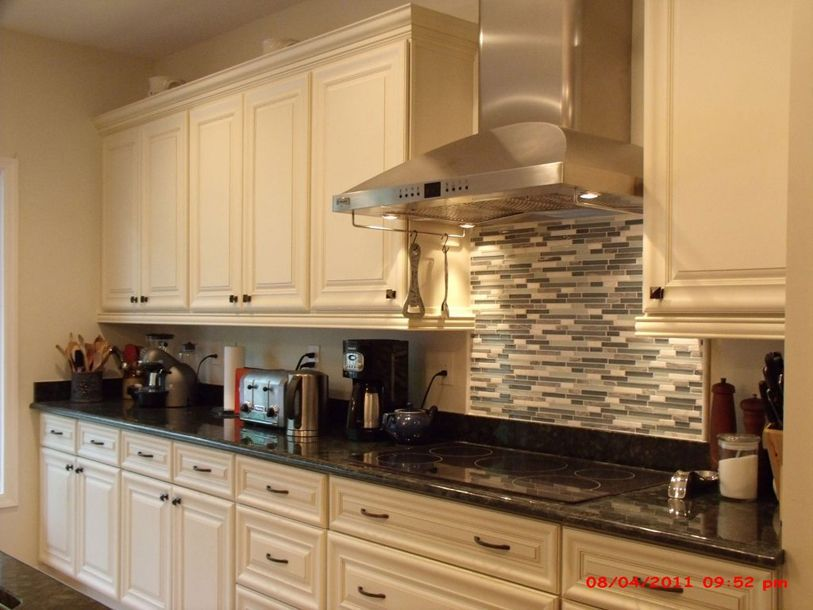 Cream painted kitchen cabinets in benjamin moore feather for Cream colored cabinets